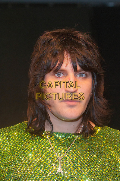 Noel Fielding (The Mighty Boosh).signs copies of his new art book,  'The Scribblings Of A Madcap Shambleton', HMV, Oxford Street , London, England. 9th October 2011.headshot portrait green beads beaded silver necklace.CAP/HT.©Hugh Thompson/Capital Pictures.