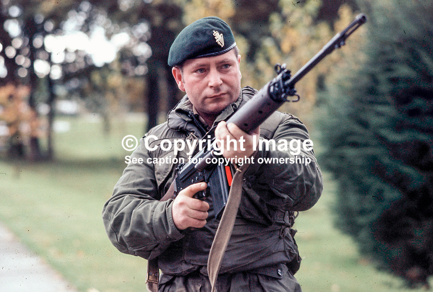 UDR soldier in N Ireland, UK, stands guard with rifle at the ready whilst his colleagues set up a random vehicle checkpoint. 444/71, 197110000444d..Copyright Image from Victor Patterson, 54 Dorchester Park, Belfast, UK, BT9 6RJ..Tel: +44 28 9066 1296.Mob: +44 7802 353836.Voicemail +44 20 8816 7153.Skype: victorpattersonbelfast.Email: victorpatterson@mac.com.Email: victorpatterson@ireland.com (back-up)..IMPORTANT: If you wish to use this image or any other of my images please go to www.victorpatterson.com and click on the Terms & Conditions. Then contact me by email or phone with the reference number(s) of the image(s) concerned.
