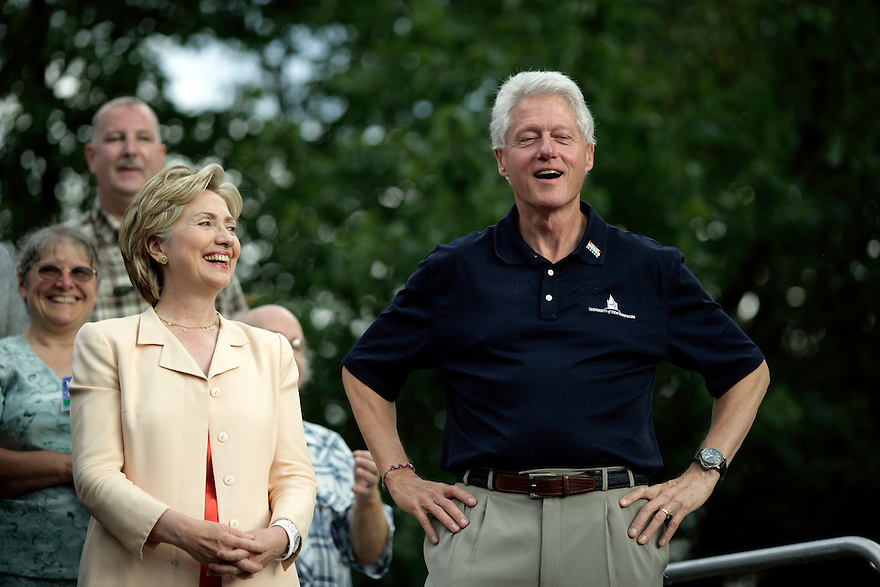 Democratic Presidential candidate and U.S. Senator Hillary Clinton (D-NY) and her husband, former U.S. President Bill Clinton, campaign in Manchester, New Hampshire July 13, 2007.<br /> Photo by Brooks Kraft/Corbis
