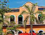A typical cafe in Mazatlan, Mexico with palm trees, bright colors ... fish tacos and a Negra Modello please!