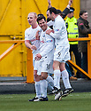 Ayr Utd's Liam Buchanan (10) is congratulated by Chris Smith (left) and Michael Moffat (9) after he scores Ayr's first goal.