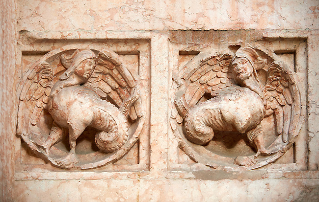 Medieval relief sculptures of mythical half human creatures on the exterior of the Romanesque Baptistery of Parma, circa 1196, (Battistero di Parma), Italy