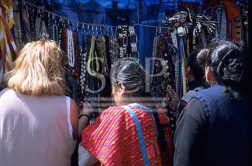 Mexico City. Indian woman selling belts and necklaces; street market, Templo Mayor,  Zocalo (Plaza de la Constitucion).