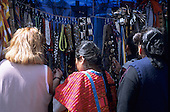 Mexico City. Indian woman selling belts and necklaces; street market, Templo Mayor,  Zocalo (Plaza de la Constitucion).