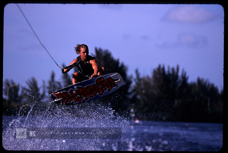 In Miami's Twin Lakes neigborhood at the Miami Wakeboard camp a local gets some air during his wakeboarding practice session.