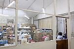 A woman works at the dispensary at Hospital Albert Schweitzer on Thursday, October 28, 2010 in Deschapelles, Haiti.