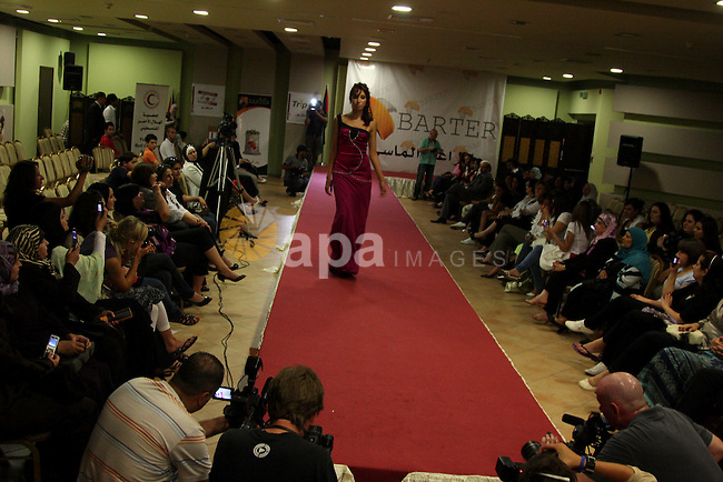 A Palestinian model presents a creation during a fashion show in the West Bank city of Ramallah August 10, 2009. Eight Palestinian designers, one of them jailed in an Israeli prison, had their creations displayed in a fashion show on Monday.  Photo by Issam Rimawi