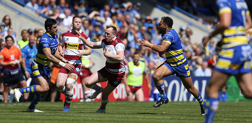 Wigan Warriors' Dan Sarginson is tackled by   Warrington Wolves' Ryan Atkins (right) and Bryson Goodwin <br /> <br /> Photographer Stephen White/CameraSport<br /> <br /> Rugby League - Coral Challenge Cup Sixth Round - Warrington Wolves v Wigan Warriors - Sunday 12th May 2019 - Halliwell Jones Stadium - Warrington<br /> <br /> World Copyright © 2019 CameraSport. All rights reserved. 43 Linden Ave. Countesthorpe. Leicester. England. LE8 5PG - Tel: +44 (0) 116 277 4147 - admin@camerasport.com - www.camerasport.com