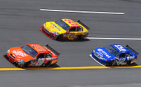 Apr 25, 2008; Talladega, AL, USA; NASCAR Sprint Cup Series driver Tony Stewart (20) leads Kevin Harvick (29) and Ryan Newman (12) during practice for the Aarons 499 at Talladega Superspeedway. Mandatory Credit: Mark J. Rebilas-US PRESSWIRE