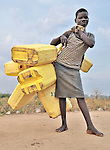 A girl in Yei, Southern Sudan, walks to a well to get water. NOTE: In July 2011, Southern Sudan became the independent country of South Sudan
