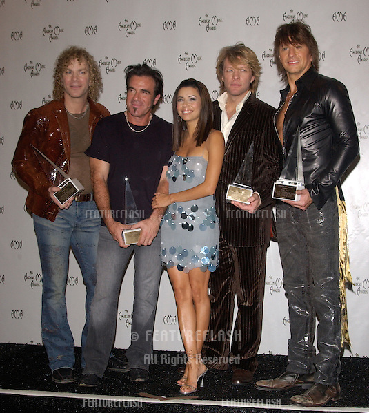 Nov 14, 2004; Los Angeles, CA: Rock group BON JOVI with actress EVA LONGORIA at the 32nd Annual American Music Awards at the Shrine Auditorium, Los Angeles, CA..