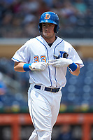 Brendan McKay (33) of the Durham Bulls makes his way to first base after drawing a walk during the game against the Columbus Clippers at Durham Bulls Athletic Park on June 1, 2019 in Durham, North Carolina. The Bulls defeated the Clippers 11-5 in game one of a doubleheader. (Brian Westerholt/Four Seam Images)