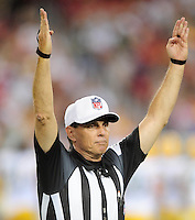 Aug. 28, 2009; Glendale, AZ, USA; NFL referee Tony Corrente signals touchdown during the game between the Arizona Cardinals against the Green Bay Packers during a preseason game at University of Phoenix Stadium. Mandatory Credit: Mark J. Rebilas-