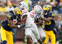 Ohio State Buckeyes wide receiver Michael Thomas (3) and quarterback J.T. Barrett (16) against Michigan Wolverines at Michigan Stadium in Arbor, Michigan on November 28, 2015.  (Dispatch photo by Kyle Robertson)