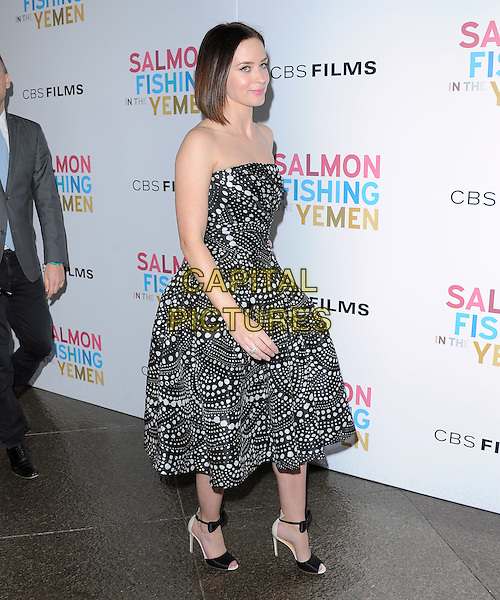 Emily Blunt.CBS Films' U.S. Premiere of 'Salmon Fishing In The Yemen' held at The Directors Guild of America in West Hollywood, California, USA..March 5th, 2012.full length white black print strapless dress profile .CAP/RKE/DVS.©DVS/RockinExposures/Capital Pictures.