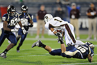 22 November 2008:  FIU linebacker Tyler Clawson (49) dives after Louisiana-Monroe wide receiver J.J. McCoy (1) in the ULM 31-27 victory over FIU at FIU Stadium in Miami, Florida.