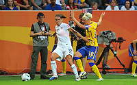 Lauren Cheney (l) of team USA and Nilla Fischer of team Sweden during the FIFA Women's World Cup at the FIFA Stadium in Wolfsburg, Germany on July 6thd, 2011.