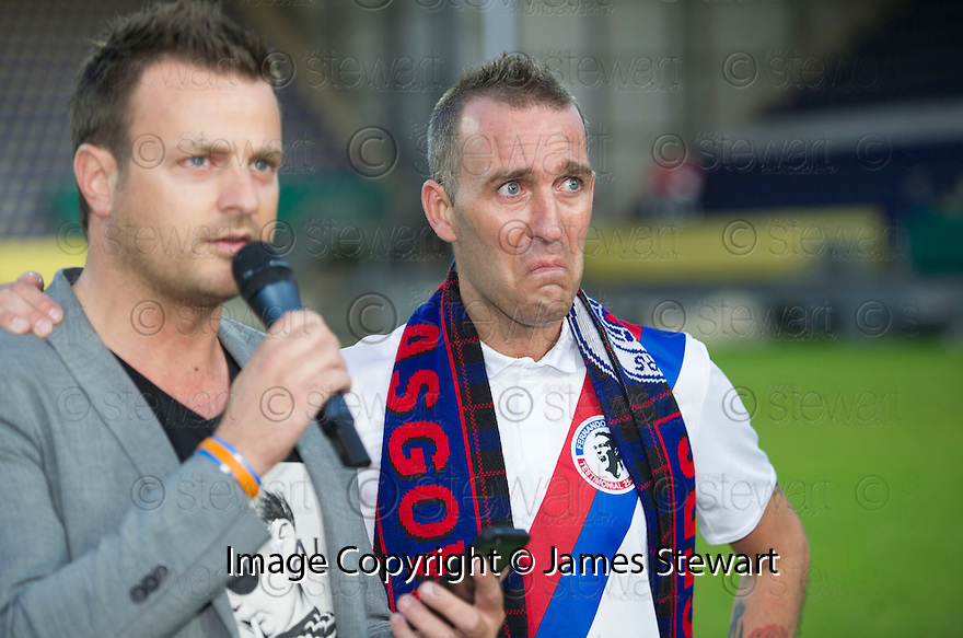 Fernando Ricksen Testimonial :  A tearful Fernando Ricksen after the game as his friend, Roy Knez, reads out a statement on his behalf.