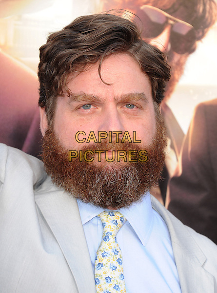 "Zach Galifianakis.""The Hangover Part III"" Los Angeles Premiere held at the Westwood Village Theater, Los Angeles, California, USA..May 20th, 2013.headshot portrait beard facial hair blue yellow tie floral print shirt grey gray.CAP/DVS.©DVS/Capital Pictures"