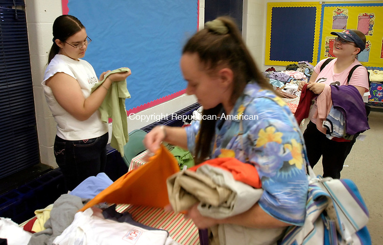 WATERBURY, CT - 20 AUGUST 2005 -082005JS04-- Sarah Morin of Waterbury along with her mother Teresa Morin and sister Jennifer Morin, shop for clothes during the Girls Inc.  shopping event at their facility Saturday in Waterbury. The clothes were donated by girls at Westover School in Middlebury and proceeds from the sale will go to help fund teen programs.   --Jim Shannon / Republican-American --Sarah Morin; Waterbury; Teresa Morin; Jennifer Morin, Girls Inc.  CQ
