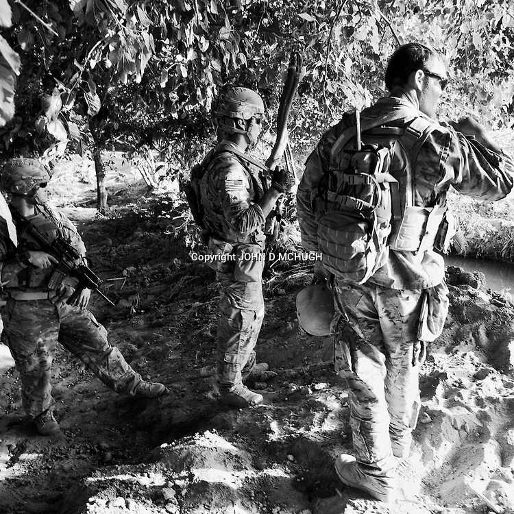 "1 Platoon, Delta Co, 1-66, 4th Infantry Division, patrol an orchard in Arghandab Valley, Kandahar, 01 May 2011, on the day the so called ""Taliban Tet Offensive"" was due to start. (John D McHugh)"