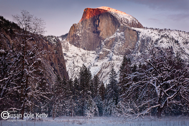 Snow on Half Dome in Yosemite National Park, CA, USA. Half Dome is a geologic feature demonstrating the force of glaciers.
