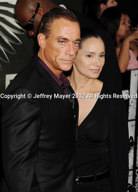 HOLLYWOOD, CA - AUGUST 15: Jean-Claude Van Damme and Gladys Portugues arrive at the 'The Expendables 2' - Los Angeles Premiere at Grauman's Chinese Theatre on August 15, 2012 in Hollywood, California.