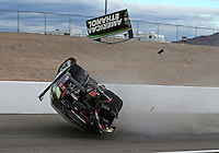 Nov 1, 2014; Las Vegas, NV, USA; NHRA pro stock driver Deric Kramer flips over as he crashes during qualifying for the Toyota Nationals at The Strip at Las Vegas Motor Speedway. Kramer was unhurt in the accident. Mandatory Credit: Mark J. Rebilas-USA TODAY Sports