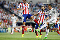 Cristiano Ronaldo of Real Madrid and Godin and Gabi of Atletico de Madrid during La Liga match between Real Madrid and Atletico de Madrid at Santiago Bernabeu stadium in Madrid, Spain. September 13, 2014. (ALTERPHOTOS/Caro Marin)