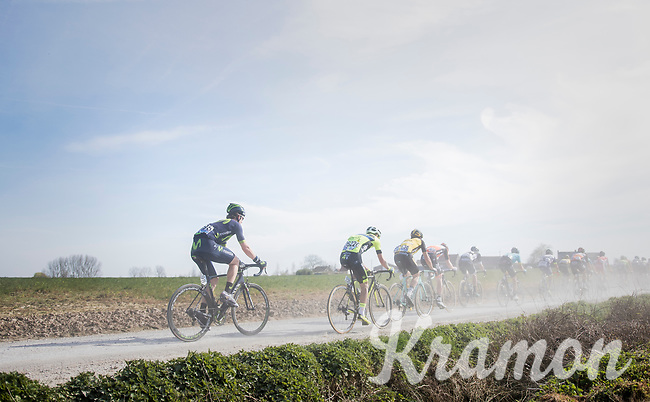 peloton racing over the newly added gravel roads around Ploegsteert, called 'Plugstreets'<br /> <br /> 79th Gent-Wevelgem 2017 (1.UWT)<br /> 1day race: Deinze &rsaquo; Wevelgem - BEL (249km)