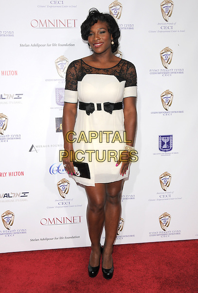 SERENA WILLIAMS .The 60th Anniversary of Israel - From Vision to Reality Gala held at Paramount Picture Studios in Hollywood, California, USA..September 18th, 2008.full length white black lace dress clutch bag belt sheer shoes platform .CAP/DVS.©Debbie VanStory/Capital Pictures.