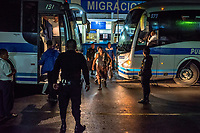 EL CARMEN, GUATEMALA - OCTOBER 15: Honduran illegal immigrants change buses after being deported from Mexico by immigration officials to the Talisman/El Carmen Mexican border crossing with Guatemala, to be driven back to Honduras by bus, on the 15th of October, 2015 in El Carmen, Guatemala. <br /> Daniel Berehulak for The New York Times