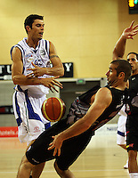 Saints forward Arthur Trousdell and Cougars forward Trenton Wurtz collide during the NBL match between the Wellington Saints and Christchurch Cougars at Te Rauparaha Stadium, Porirua, Wellington, New Zealand on Saturday 4 April 2009. Photo: Dave Lintott / lintottphoto.co.nz