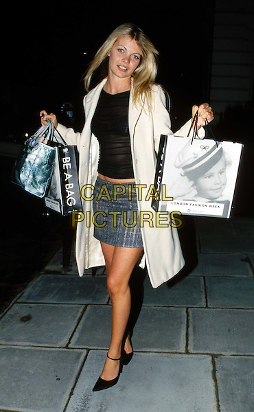 EMMA KIDD..Ref: 11056..miniskirt, legs, anya hindmarch bags, full length, full-length..www.capitalpictures.com..sales@capitalpictures.com..©Capital Pictures