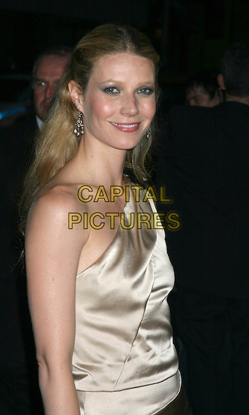 """GWYNETH PALTROW.""""Proof """" Premiere at The Ziegfeld Theater,.New York, 13th September 2005.portrait headshot cream satin dress shoulder dress layered   bow silver earrings.Ref: IW.www.capitalpictures.com.sales@capitalpictures.com.©Capital Pictures"""