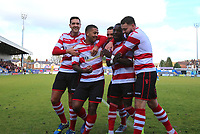 Kingstonian players celebrate their opening goal scored by Dan Hector during Macclesfield Town vs Kingstonian, Emirates FA Cup Football at the Moss Rose Stadium on 10th November 2019