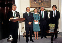 United States President Bill Clinton makes remarks as he participates in the annual presentation of a bowl of shamrocks honoring St. Patrick's Day with Taoiseach (Prime Minister) Albert Reynolds of Ireland in the Roosevelt Room of the White House in Washington, DC on March 17, 1993. During his remarks, President Clinton announced he was naming Jean Kennedy Smith as US Ambassador to Ireland.  From left to right: President Clinton, Prime Minister Reynolds, Jean Kennedy Smith, US Senator Ted Kennedy (Democrat of Massachusetts) and US Representative Joseph P. Kennedy II (Democrat of Massachusetts).<br /> Credit: Martin H. Simon / Pool via CNP/AdMedia