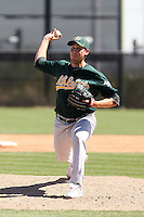 Zach Thornton #67 of the Oakland Athletics plays in a minor league spring training game against the San Francisco Giants at Papago Park on March 31, 2011 in Phoenix, Arizona. .Photo by:  Bill Mitchell/Four Seam Images.