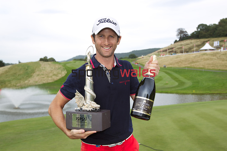 2013 ISPS Handa Wales Open champion Gregory Bourdy celebrates with the trophy and champagne at the<br /> Celtic Manor Resort<br /> <br /> 01.09.13<br /> <br /> ©Steve Pope-Sportingwales