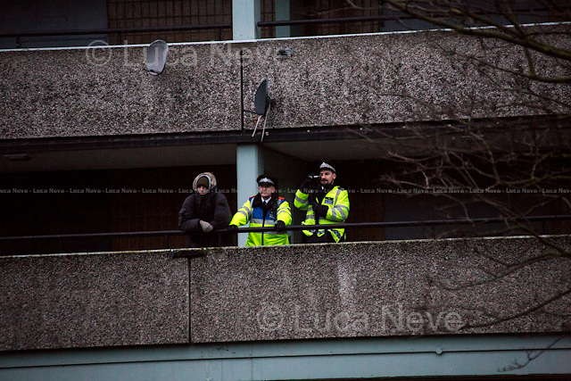 """London, 31/01/2015. At the end of """"The March For Homes"""", some activists tried symbolically to occupy the luxury housing development called """"One Tower Bridge"""". The demonstration ended, after a short march, at the Aylesbury Estate (""""one of the most notorious estates in the United Kingdom"""", located in Walworth, South East London) where some boarded up homes, ready to be demolished """"to regenerate and revitalise the area"""", were reclaimed and reoccupied by activists."""