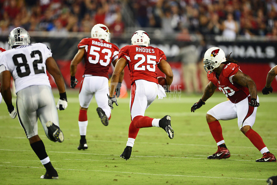 Aug. 17, 2012; Glendale, AZ, USA; Arizona Cardinals safety (25) Kerry Rhodes returns an interception in the second half against the Oakland Raiders during a preseason game at University of Phoenix Stadium. Mandatory Credit: Mark J. Rebilas-