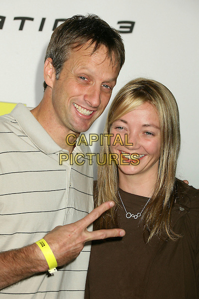 TONY HAWK & WIFE LHOTSE.Best Buy's Playstation 3 Launch Celebration and Block Party at Best Buy West Hollywood, West Hollywood, California, USA,16 November 2006..half length couple married husband peace sign gesture.CAP/ADM/BP.©Byron Purvis/AdMedia/Capital Pictures.