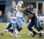 Tennessee Titans'  guard Steve Hutchinson (L) blocks Seattle Seahawks' linebacker Leroy Hill in a pre-season game CenturyLink Field in Seattle, Washington on August 11, 2012.©2012. Jim Bryant Photo. All Rights Reserved...