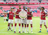 Arsenal's Olivier Giroud; Danny Welbeck and Theo Walcott with the trophy after the The FA Community Shield Final match between Arsenal and Chelsea at Wembley Stadium, London, England on 6 August 2017. Photo by Andrew Aleksiejczuk / PRiME Media Images.