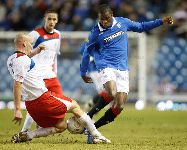 Maurice Edu narrowly avoids a Ross Tokely cruncher