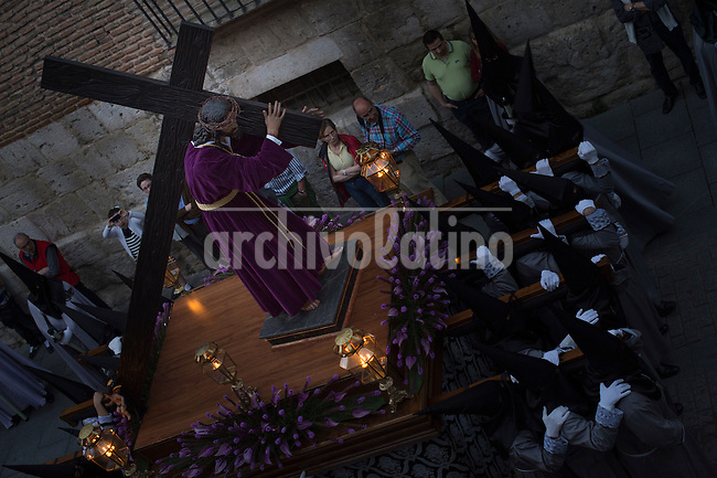 VALLADOLID, APRIL, 17, 2014. Image of a christ carrying the cross during a Holy Week procession in Valladolid, Spain, Thursday, April 17, 2014. Holy week in Valladolid is known for the more than 20 sculptures, from the National Museum of Esculptur, which are said as a street museum, and the more than 19 brotherhoods which take part in differents processions during the week. Patricio Realpe/Archivolatino