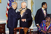 "The recipients of the 16th Annual Kennedy Center Honors share an informal moment as they pose for a group photo following a dinner at the United States Department of State in Washington, D.C. on Saturday, December 4, 1993.  From left to right: conductor Georg Solti, former ""Tonight Show"" host Johnny Carson, Arthur Mitchell, founder of the Dance Theatre of Harlem and gospel singer Marion Williams.  The 1993 honorees are: Johnny Carson, Arthur Mitchell, Georg Solti Stephen Sondheim and Marion Williams.<br /> Credit: Greg E. Mathieson / Pool via CNP"