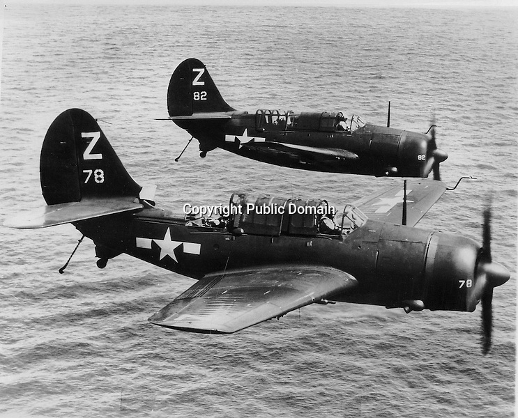 Two Curtiss SB2C-4 Helldivers from the U.S.S. Shangri-La (CV 38) Bombing Squadron 85 (VB-85) - Date: mid July to Sept. 1945