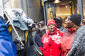 Angry protestors took to the streets Friday morning, the largest shopping day of the year, down the Magnificent Mile in downtown Chicago to show the city that the people will not tolerate city corruption any more, especially the level of corruption that led to the murder and cover up of 17 Year old LaQuan McDonald by a Chicago Police Officer.  #&lrm;LaQuanMcDonald<br /> <br /> Please 'Like' &quot;Spencer Bibbs Photography&quot; on Facebook.<br /> <br /> All rights to this photo are owned by Spencer Bibbs of Spencer Bibbs Photography and may only be used in any way shape or form, whole or in part with written permission by the owner of the photo, Spencer Bibbs.<br /> <br /> For all of your photography needs, please contact Spencer Bibbs at 773-895-4744. I can also be reached in the following ways:<br /> <br /> Website &ndash; www.spbdigitalconcepts.photoshelter.com<br /> <br /> Text - Text &ldquo;Spencer Bibbs&rdquo; to 72727<br /> <br /> Email &ndash; spencerbibbsphotography@yahoo.com