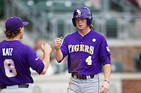 LSU Tigers outfielder Raph Rhymes (4) is greeted by teammate Mason Katz (8) after he scored against the Texas A&M Aggies in the NCAA Southeastern Conference baseball game on May 10, 2013 at Blue Bell Park in College Station, Texas. LSU defeated Texas A&M 7-4. (Andrew Woolley/Four Seam Images).